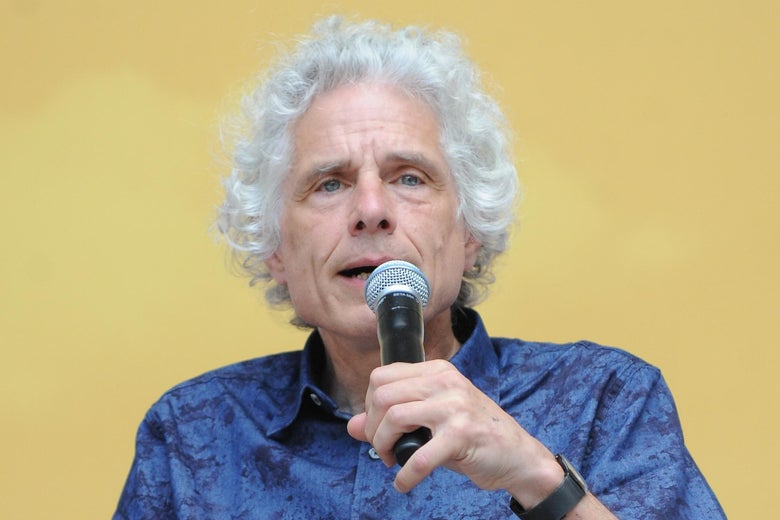 Steven Pinker holds a microphone.