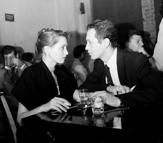 A couple having a drink, circa 1942.