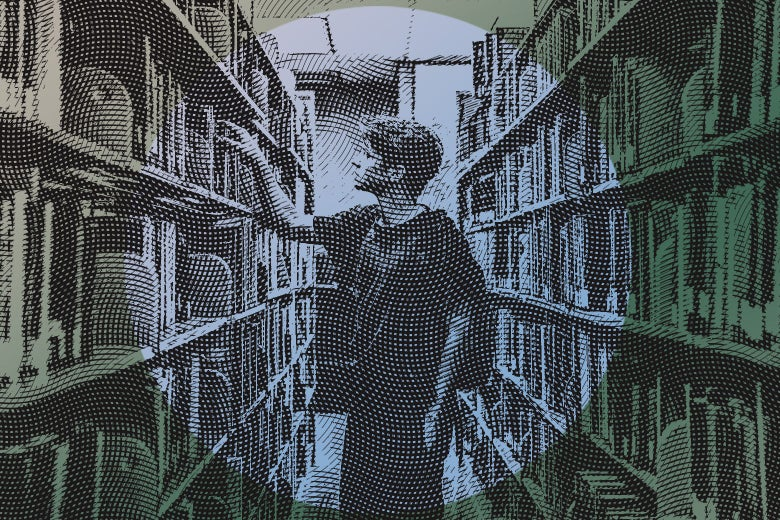 male college student browsing library books