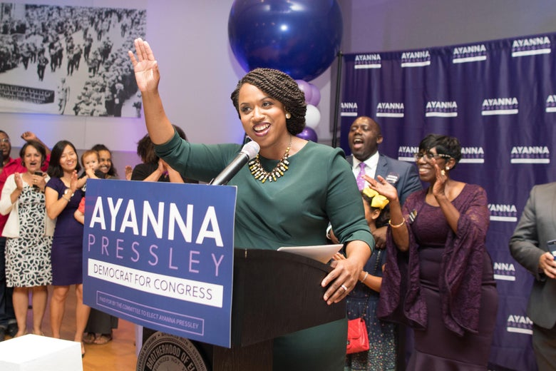 Ayanna Pressley surrounded by balloons and cheering supporters