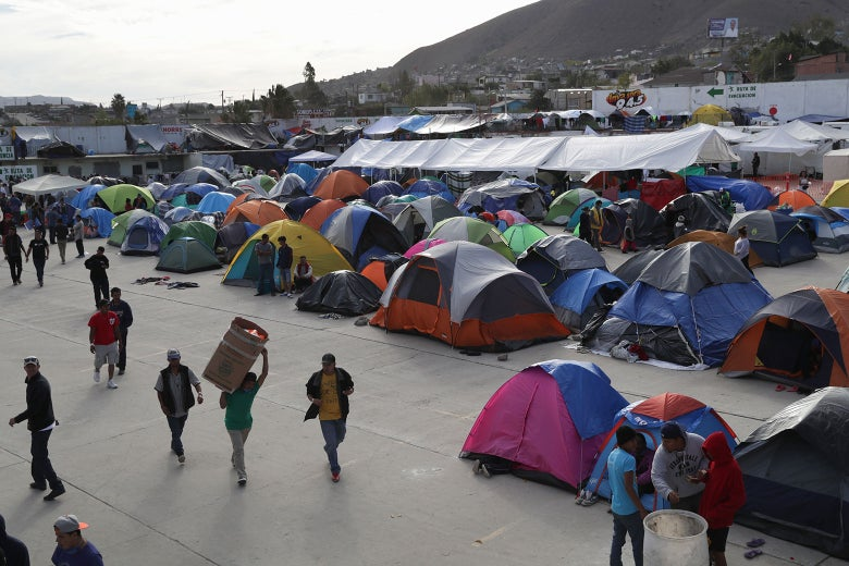 Immigrants spend the afternoon inside the Barretal migrant camp on Dec. 4, 2018 from Tijuana, Mexico.