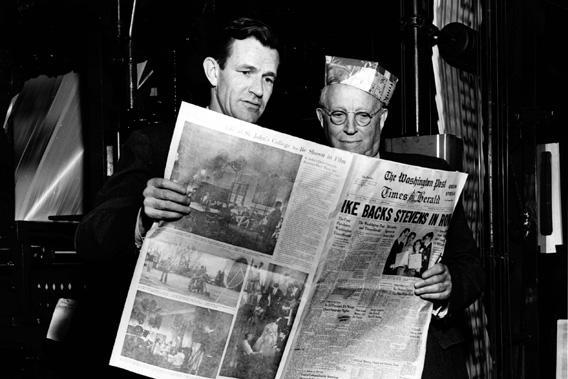 Philip L. Graham and Eugene Meyer hold a copy of The Washington Post, on March 18, 1954.