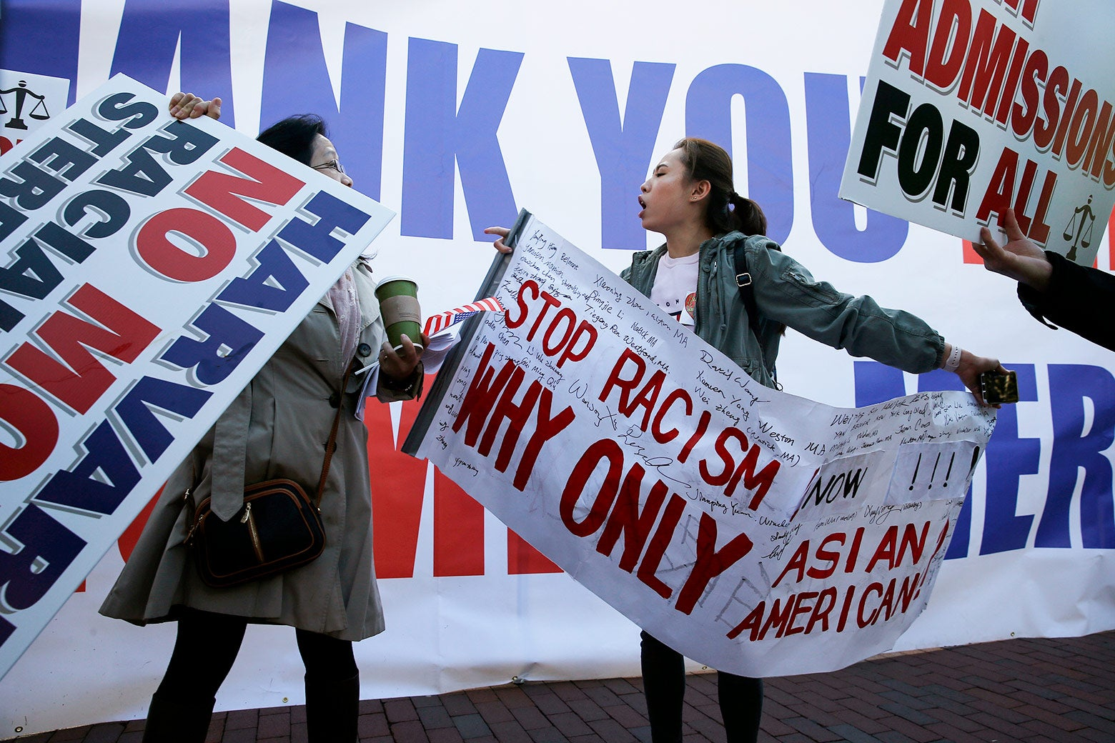 A scuffle between protesters ensues as a group of Chinese Americans who support President Trump raised a banner thanking the president at a rally in Boston to support SFFA's lawsuit against Harvard on Sunday.