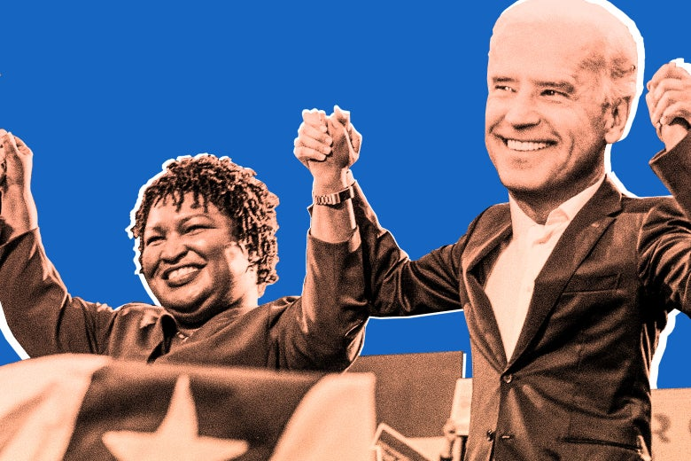 Stacey Abrams and Joe Biden photoshopped together, holding hands with their arms raised.