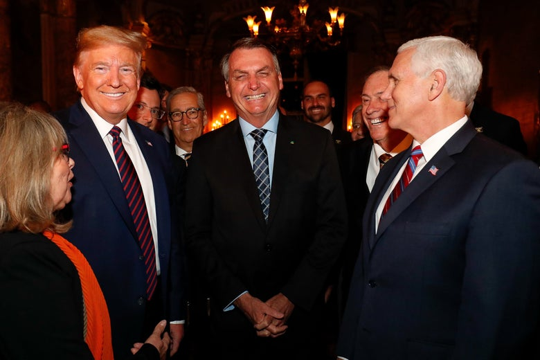 President Donald Trump and Vice President Mike Pence with the Brazilian delegation, including Fábio Wajngarten (over Trump's shoulder), in Miami on Saturday.