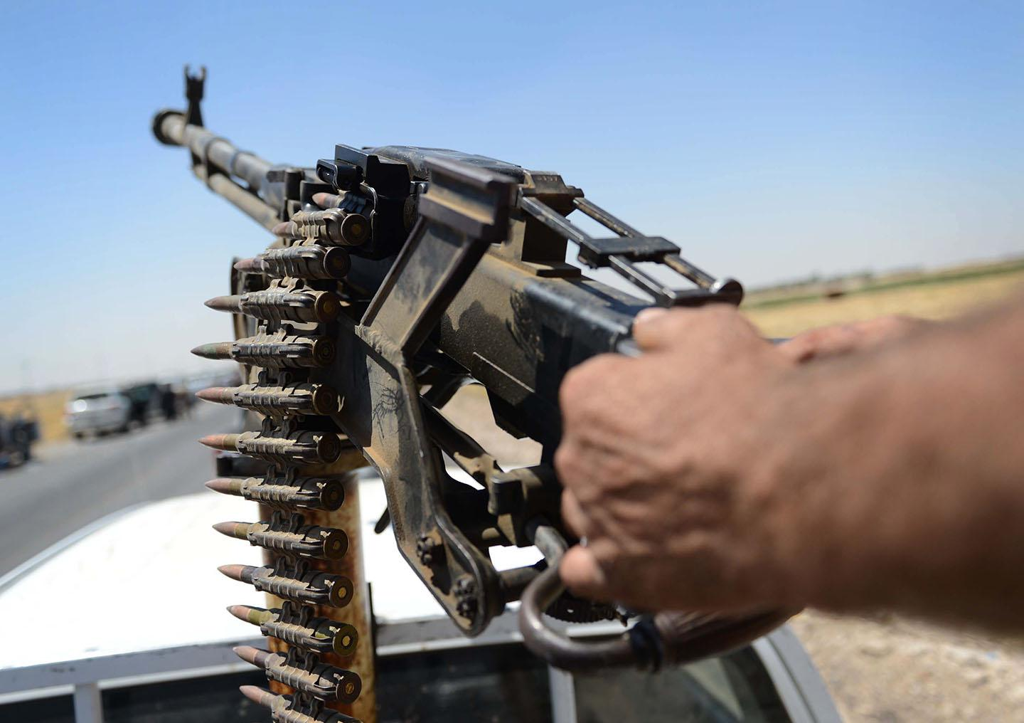 A member of Peshmerga forces in action during the clashes with ISIS militants on August 10, 2014 in Mosul, Iraq.