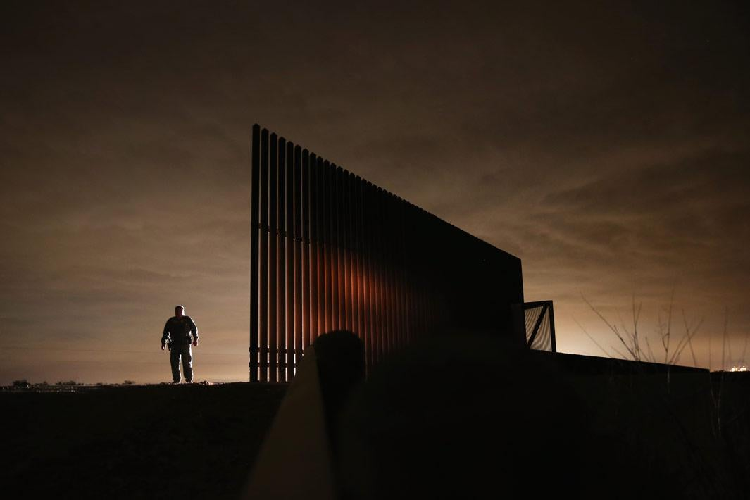 La Joya, Texas  U.S. Border Patrol agent Sal De Leon stands near a section of the U.S.- Mexico border fence while stopping on patrol on April 10, 2013 in La Joya, Texas. According to the Border Patrol, undocumented immigrant crossings have increased more than 50 percent in Texas' Rio Grande Valley sector in the last year. Border Patrol agents say they have also seen an additional surge in immigrant traffic since immigration reform negotiations began this year in Washington D.C. Proposed refoms could provide a path to citizenship for many of the estimated 11 million undocumented workers living in the United States.