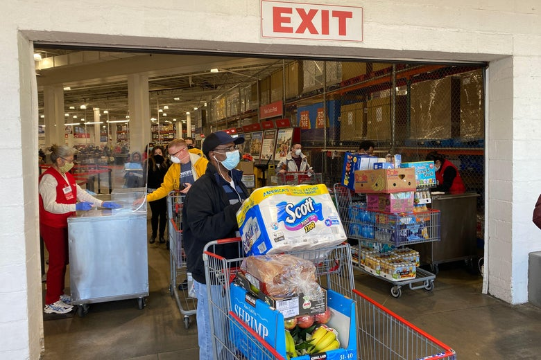 Shoppers wear masks as they get supplies at a Costco on April 18, 2020, in Arlington, Virginia.