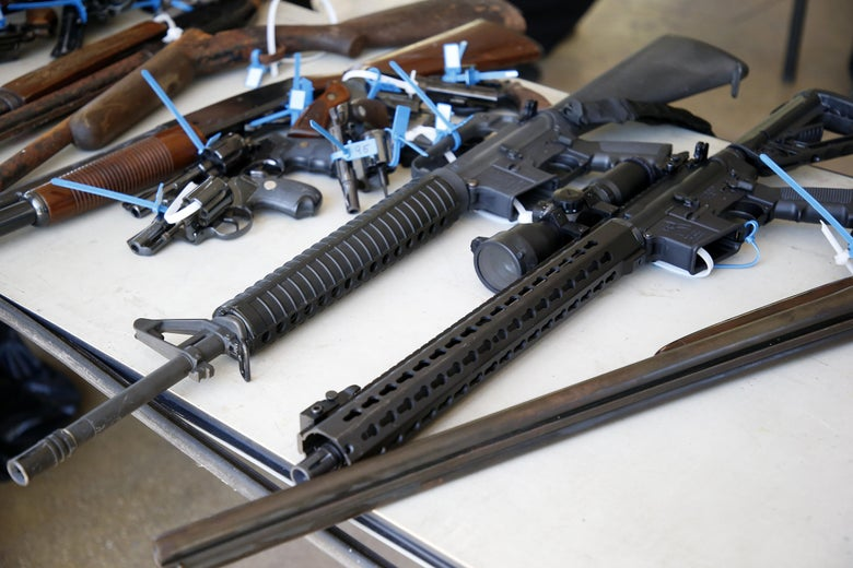 Two AR-15 rifles, along with other assorted guns