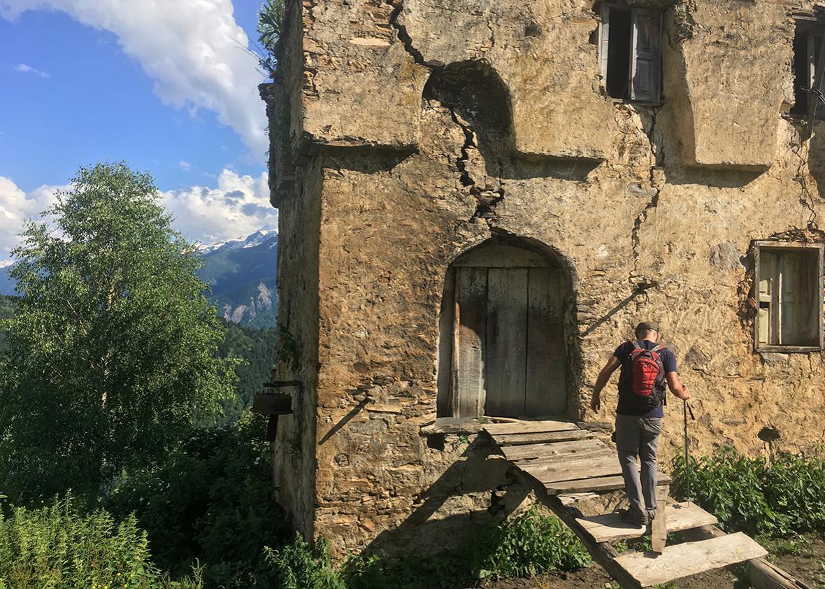 Austin Cowley explores a crumbling koshki beside the home of Nino in Svaneti, Georgia.