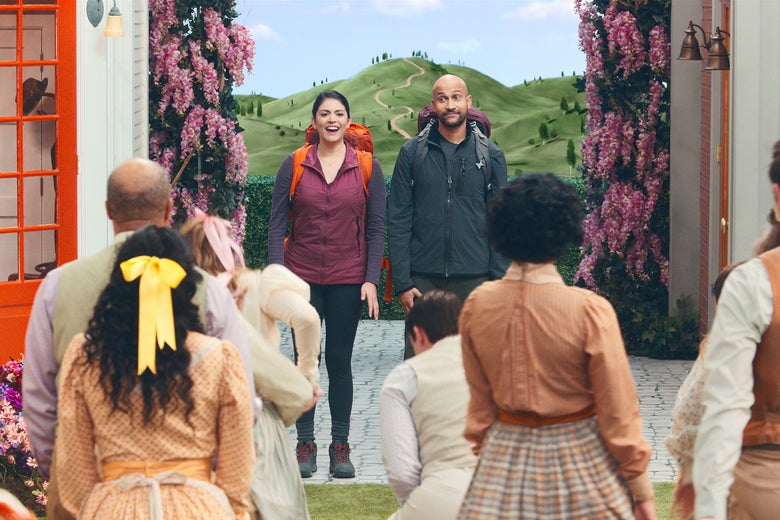cecily strong and keegan-michael key survey a group of costumed performers