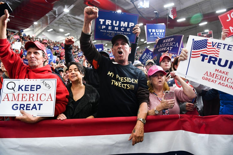 Supporters of President Donald Trump look on before he arrives for a campaign rally at Southport High School in Indianapolis, Indiana, on November 2, 2018.