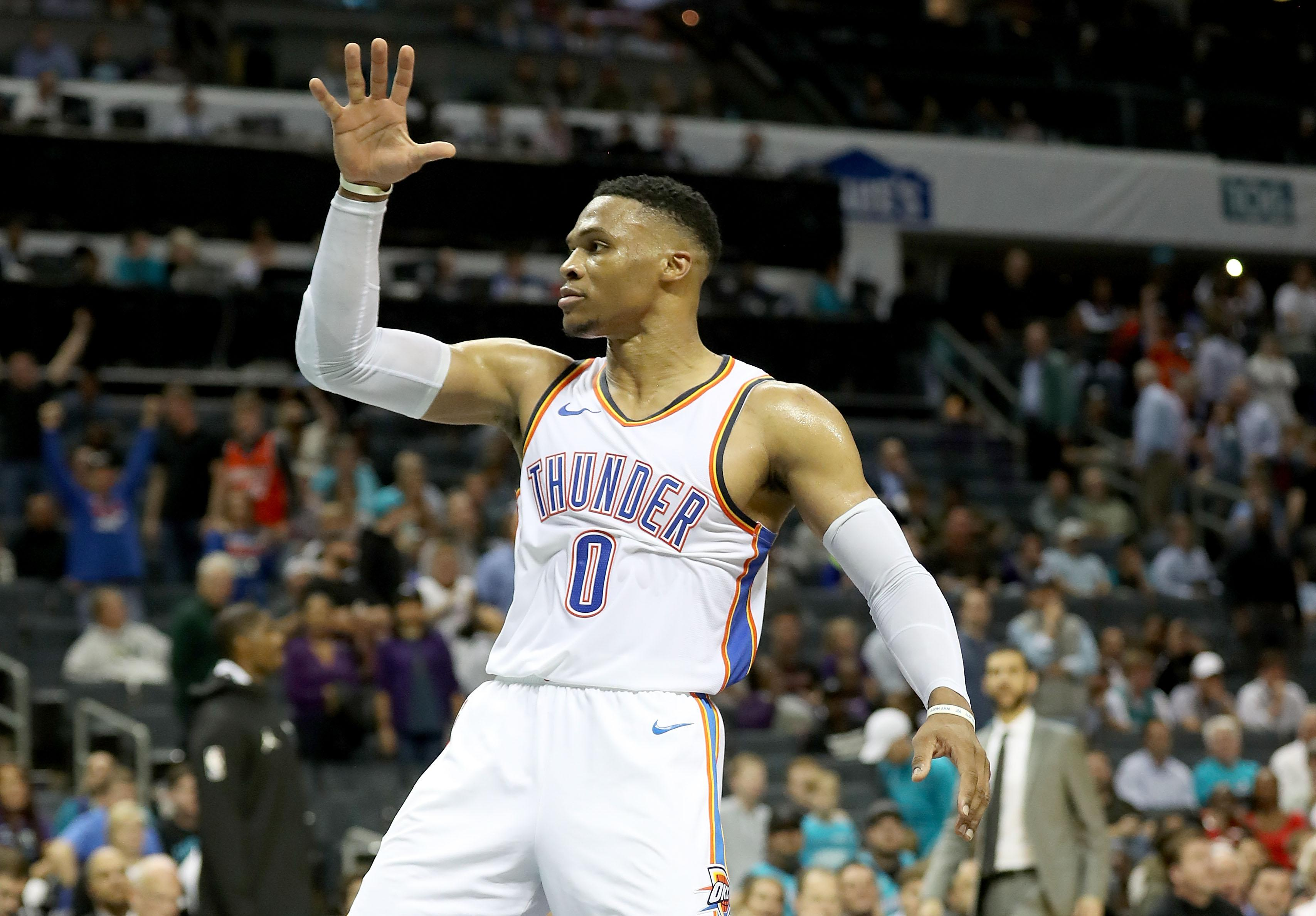 CHARLOTTE, NC - NOVEMBER 01:  Russell Westbrook #0 of the Oklahoma City Thunder reacts after a dunk against the Charlotte Hornets during their game at Spectrum Center on November 1, 2018 in Charlotte, North Carolina. NOTE TO USER: User expressly acknowledges and agrees that, by downloading and or using this photograph, User is consenting to the terms and conditions of the Getty Images License Agreement.  (Photo by Streeter Lecka/Getty Images)
