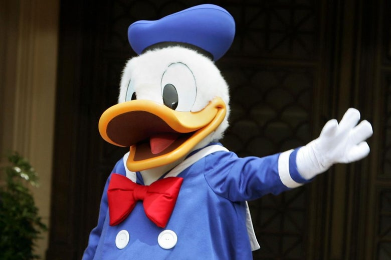 A person in a Donald Duck costume gestures with its hand.