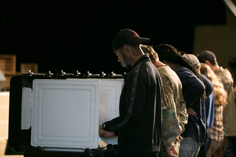 Voters cast their ballots in a polling place.