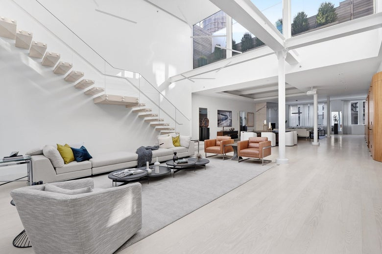 A very expensive two-story penthouse with sweeping outdoor space