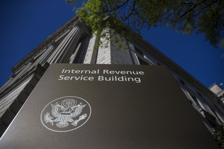 A sign says Internal Revenue Service Building outside a building in D.C.