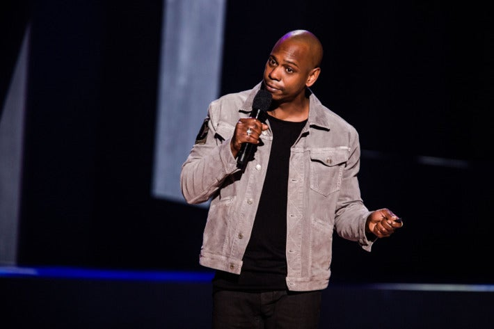 Dave Chappelle on stage in one of his Netflix stand-up specials.