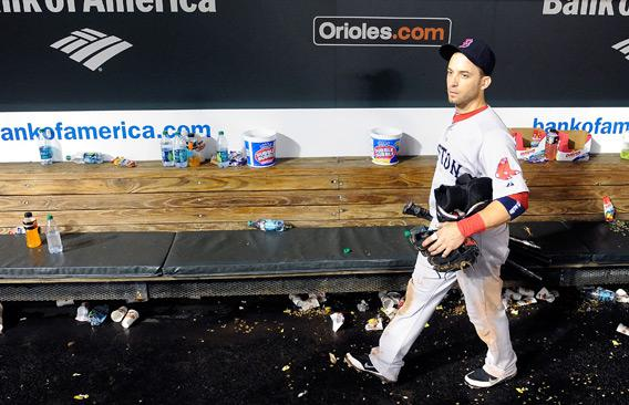 Marco Scutaro, No. 10 of the Boston Red Sox, walks in the dugout after a 4-3 loss against the Baltimore Orioles.