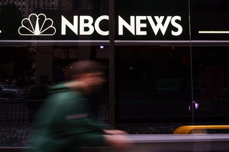 A pedestrian walks past the NBC News studios.