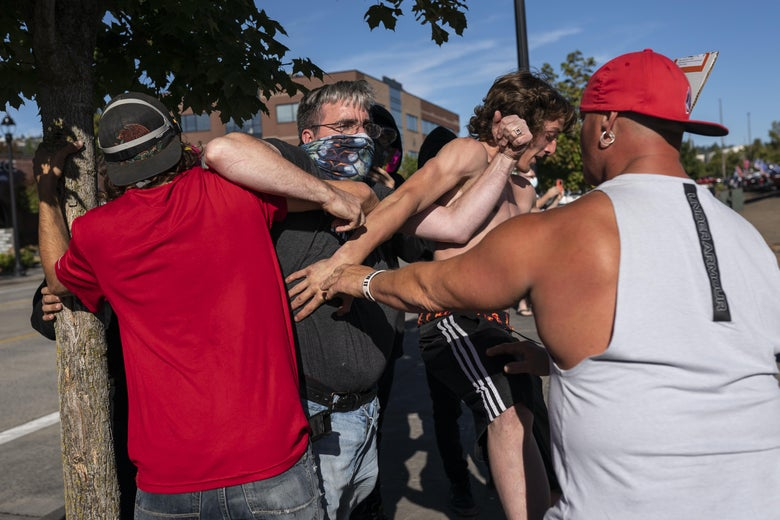 A Black Lives Matter protester scuffles with attendees of a pro-Trump rally during an event held to show support for the president on August 29, 2020 in Clackamas, Oregon.