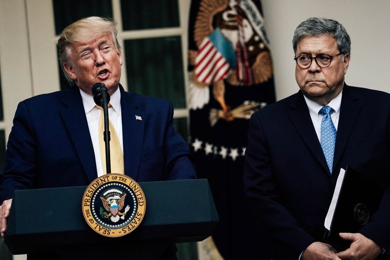 President Donald Trump makes a statement with Attorney General William Barr.