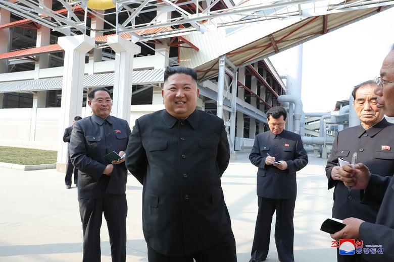Kim Jong-un and senior officials touring a factory.
