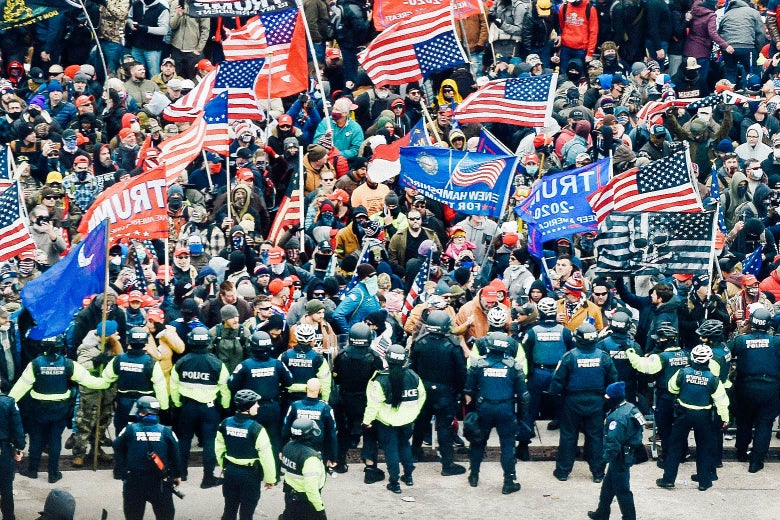 A row of police keep the Trump supporters away from the US Capital.
