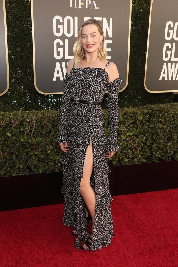 Margot Robbie walks the step and repeat at the Golden Globes.