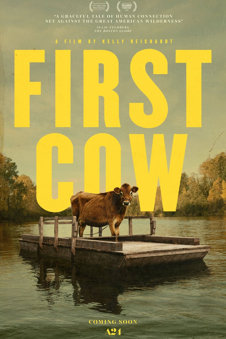 "First Cow movie poster. Eve stands on a raft over calm waters, looming in front of the words ""First Cow."""