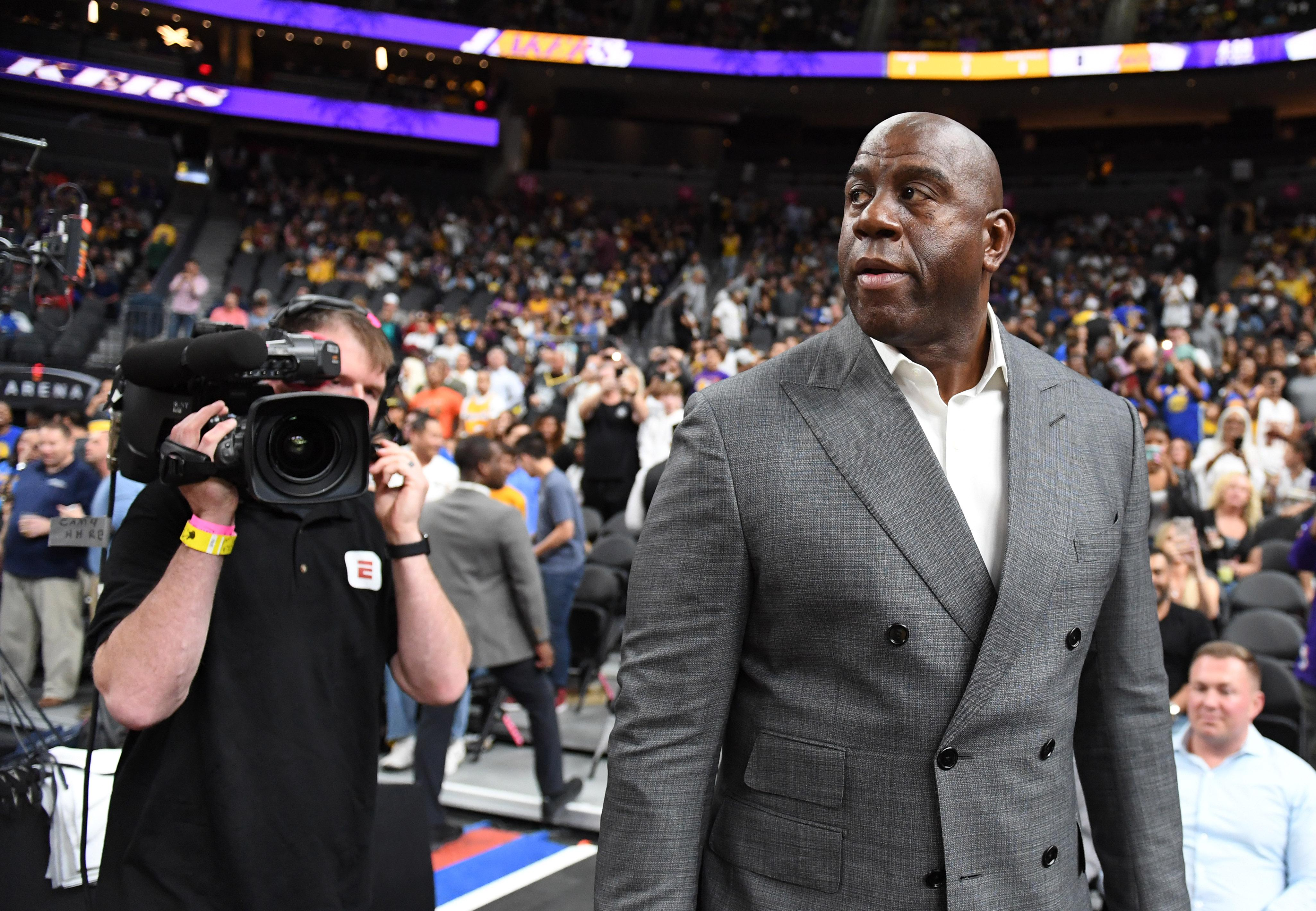 LAS VEGAS, NEVADA - OCTOBER 10:  Los Angeles Lakers president of basketball operations Earvin 'Magic' Johnson arrives at the Lakers' preseason game against the Golden State Warriors at T-Mobile Arena on October 10, 2018 in Las Vegas, Nevada. The Lakers defeated the Warriors 123-113. NOTE TO USER: User expressly acknowledges and agrees that, by downloading and or using this photograph, User is consenting to the terms and conditions of the Getty Images License Agreement.  (Photo by Ethan Miller/Getty Images)