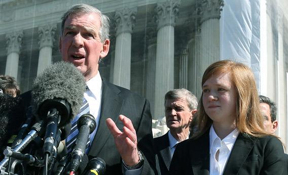 Attorney Bert Rein (L), speaks to the media while standing with plaintiff Abigail Noel Fisher (R), after the U.S. Supreme Court heard arguments.