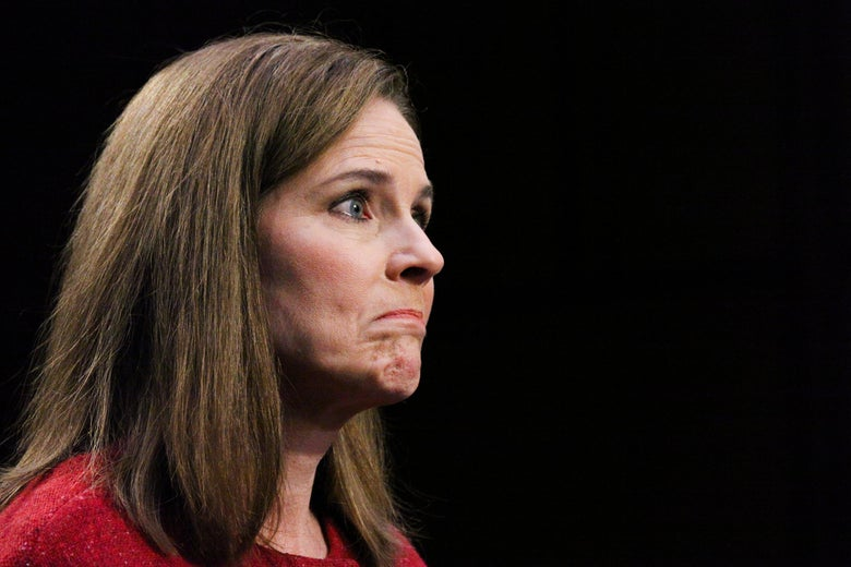 Supreme Court nominee Judge Amy Coney Barrett, from the side, frowning.