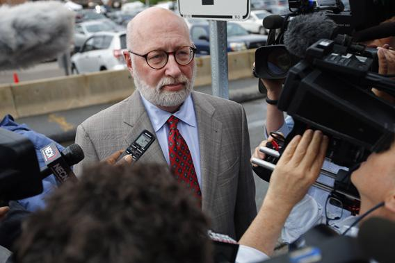 "J.W. Carney, defense attorney for accused mob boss James ""Whitey"" Bulger, talks to reporters as he arrives at the U.S. Federal Courthouse for the start of Bulger's trial in Boston."