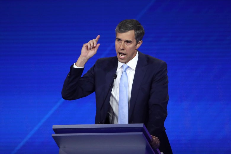 Beto O'Rourke raises his hand as he speaks during the debate.