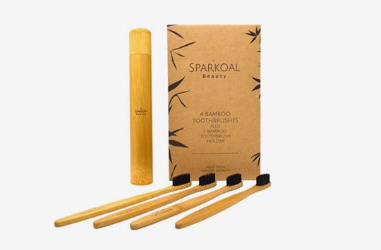Bamboo toothbrush with charcoal bristles.