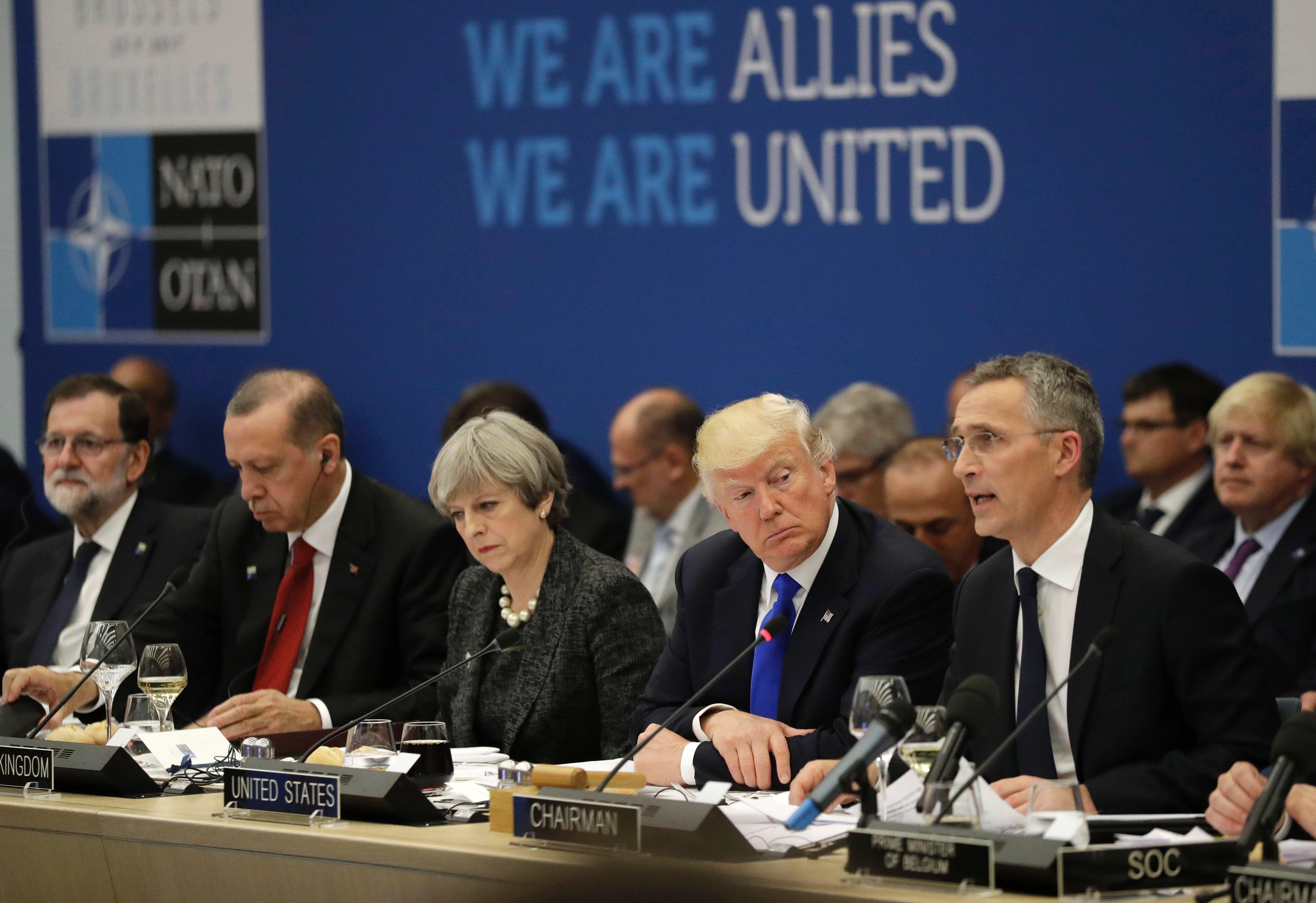 Turkey's President Recep Tayyip Erdogan, Britain's Prime Minister Theresa May, US President Donald Trump look on as NATO Secretary General Jens Stoltenberg speaks during the 2017 NATO summit in Brussels