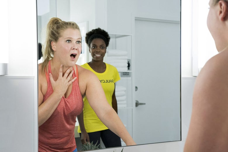 Amy Schumer's character looks in the mirror after bumping her head in the film I Feel Pretty.