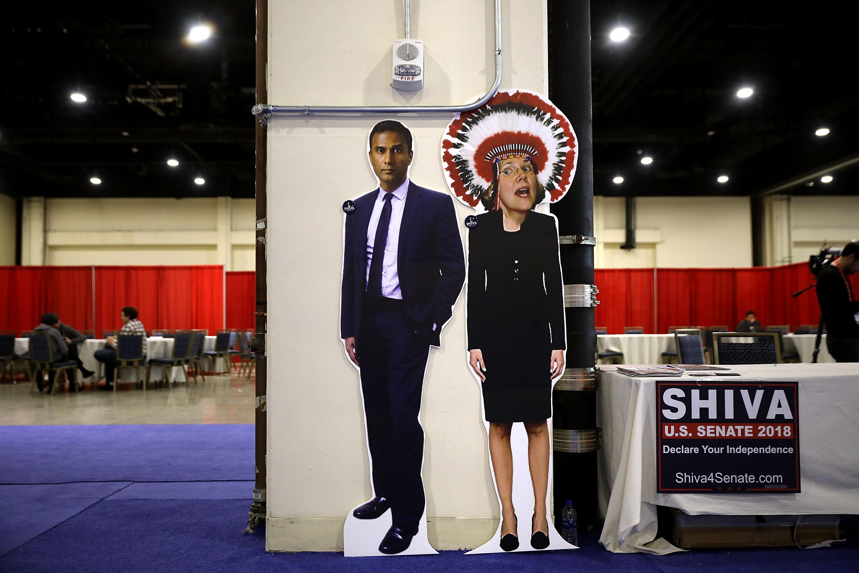 A booth in support of Shiva Ayyadurai, who is running against Sen. Elizabeth Warren (D-MA), displays a photoshopped image of Warren wearing a Native American headdress inside the Conservative Political Action Conference on February 23, 2018 in National Harbor, Maryland.