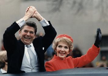 Ronald Reagan and Nancy Reagan waving from their limousine during the Inaugural Parade in Washington, D.C. on Inauguration Day, 1981.