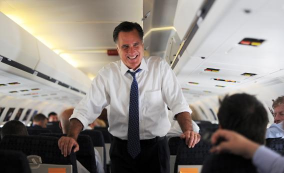 Mitt Romney chats with journalists onboard his campaign plane at Philadelphia International Airport Friday