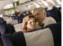 Passengers comfort each other in United 93 Click image to expand.