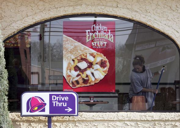 A woman cleans a Taco Bell
