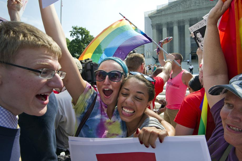 Gay rights activists reacts outside the US Supreme Court building in Washington DC on June 26, 2013, after the court ruling on California's Proposition 8, the controversial ballot initiative that defines marriage as between a man and a woman.