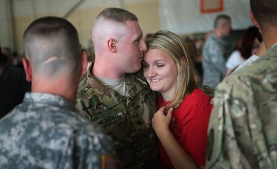 Soldiers from the 713th Engineer Company of the Indiana Army National Guard are greeted by family.