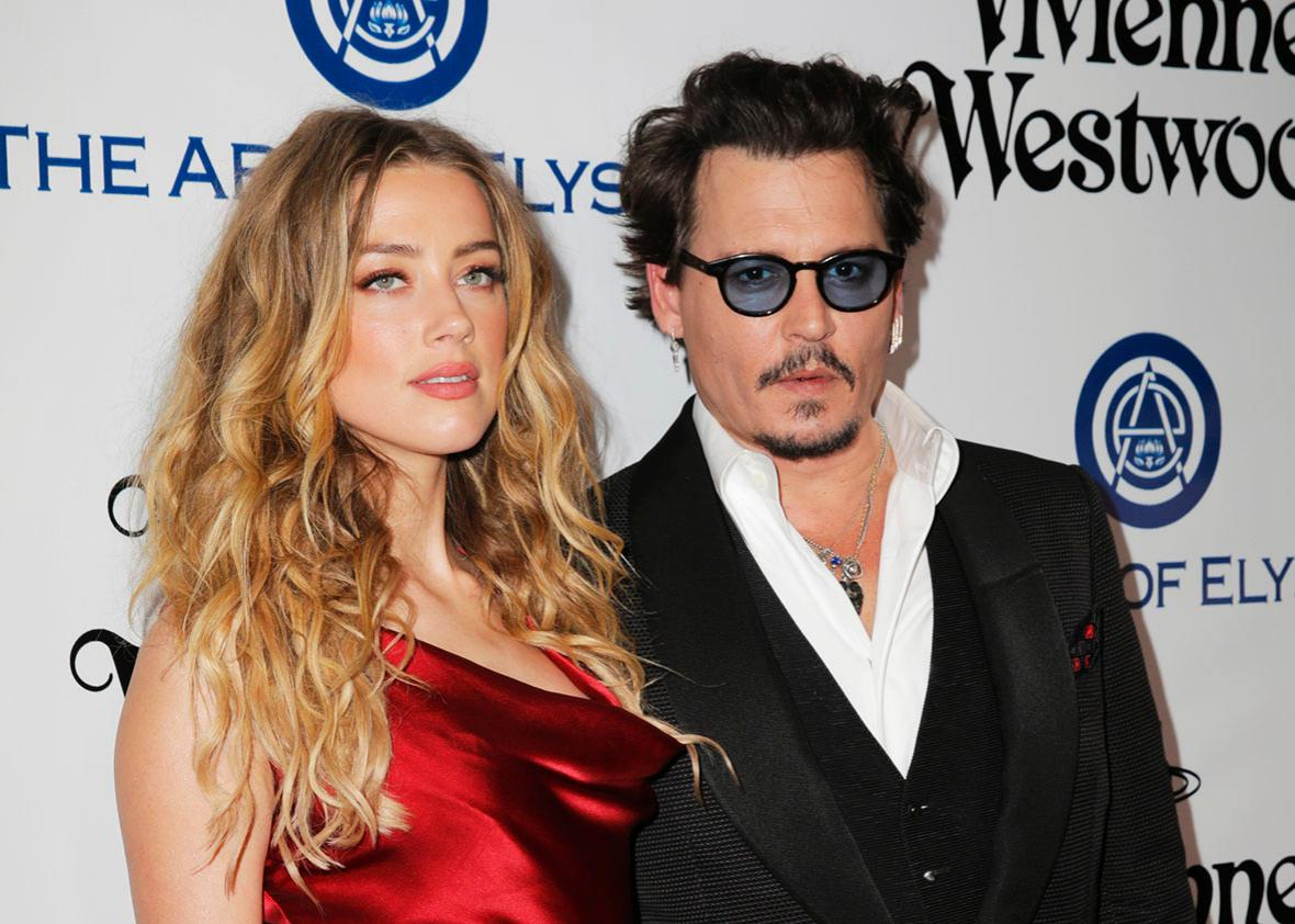 Amber Heard and Johnny Depp attend The Art of Elysium 2016 Heaven Gala on Jan. 9 in Culver City, California.