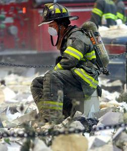 A firefighter at the World Trade Center on Sept. 11. Click image to expand.