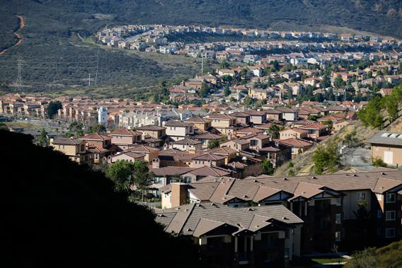 The sprawl of new housing is shown in the hills of San Marcos, California, January 30, 2013.