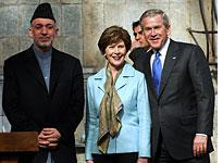 Afghan President Hamid Karzai, first lady Laura Bush, and U.S. President George W. Bush. Click image to expand.