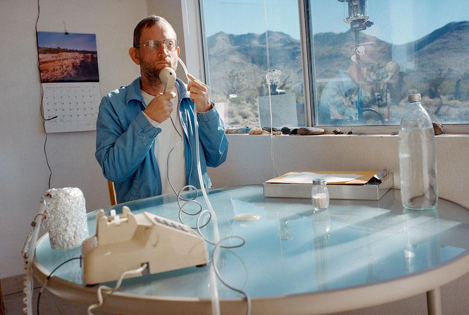 Thilde Jensen Canaries Man using his ultra-low-radiation phone. Dolan Springs, Ariz., 2005.